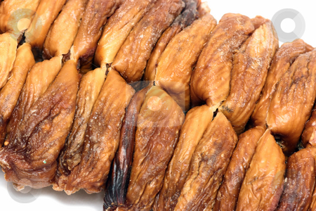 Dried fig close-up stock photo, Two rows of a dried figs by Natalia Macheda