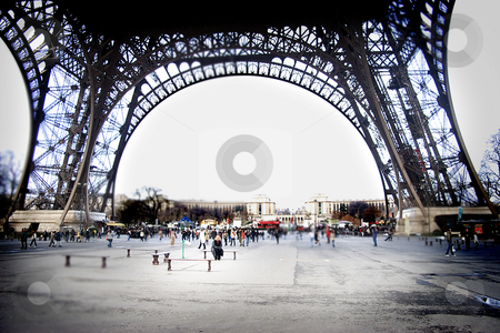 Under the Eiffel tower stock photo, A view under the eiffel tower, making appear people as toys by Heiko Riemann