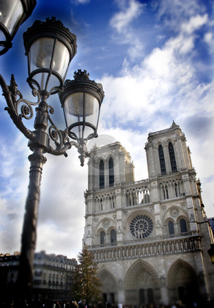 Streetlamp and Notre Dame stock photo, A street lamp in front of Notre Dame by Heiko Riemann