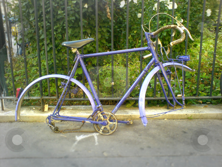 Old bike stock photo, Old bike leaning on a fence by Heiko Riemann