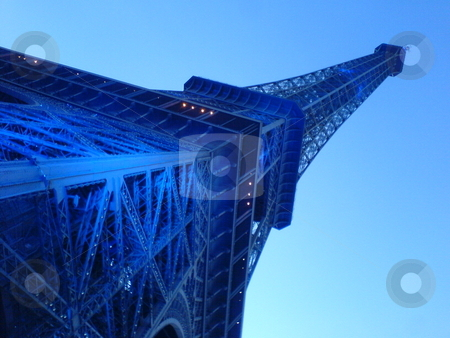 Blue Eiffel tower  stock photo, Eiffel tower in a blue lightning by Heiko Riemann