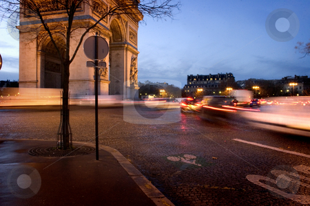 Rush hour in Paris stock photo, Cars are driving around the triumphal arch in Paris by Heiko Riemann