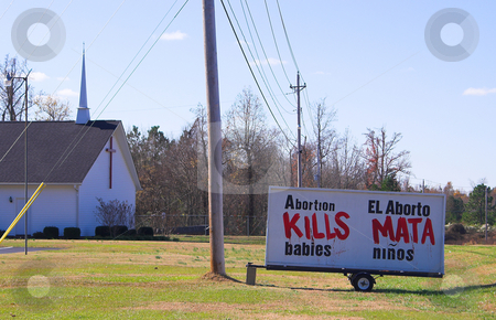 Abortion Kills stock photo, An Abortion Kills sign outside of a church in the bible belt USA. by Robert Byron