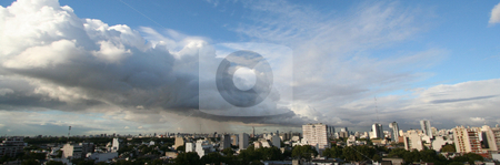 Buenos Aires cloud wall stock photo, A wall of clouds slides from the right side over the panorama view of the city of Buenos Aires by Johannes Reschl
