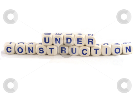 Under Construction stock photo, Spelling Blocks saying Under Construction Isolated on a White Background by Adrian Mace