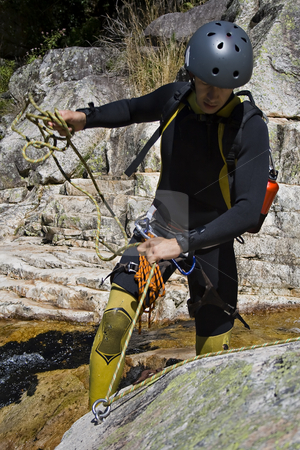 Men prepering for descending stock photo, Men prepering for descending waterfall in rappel by Paulo Resende
