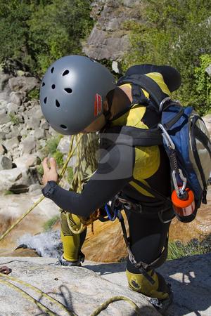 Men prepering for descending stock photo, Men prepering for descending waterfall in rappel by Paulo Resende