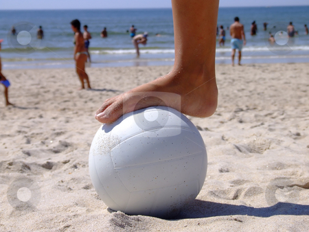 Foot on the volleyball  stock photo, Woman foot on a volleyball on the sand by Paulo Resende
