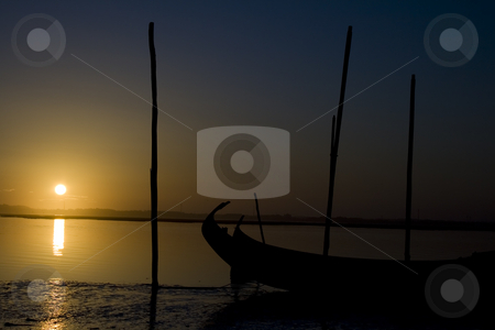 Moliceiro boat on the sunset stock photo, Typycal moliceiro portuguese boat on the sunset by Paulo Resende