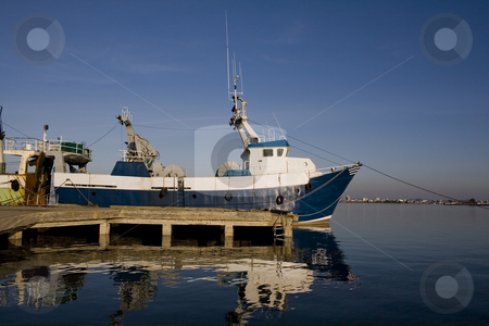 Ship on dock stock photo, Fishing ship into the harbor by Paulo Resende