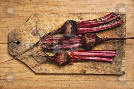 Beets on wooden table. stock photo, Beets on wooden table. by Pablo Caridad