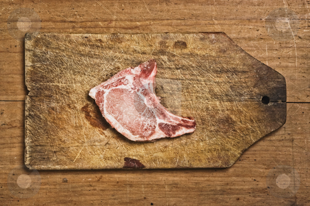 Raw Pork Chop stock photo, Raw Pork Chop isolated on cutting table. Studio shot. by Pablo Caridad