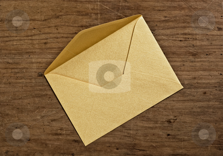 Open golden envelope stock photo, Open golden envelope, close up, studio shot. by Pablo Caridad