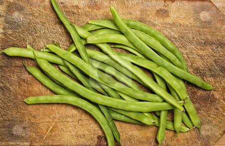 Green beans stock photo, Green beans on wooden table, studio shot. by Pablo Caridad