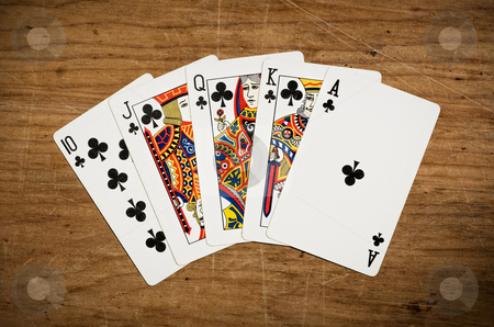 Rotyal flush, poker hand  stock photo, Rotyal flush, poker hand on an old scratched table. by Pablo Caridad
