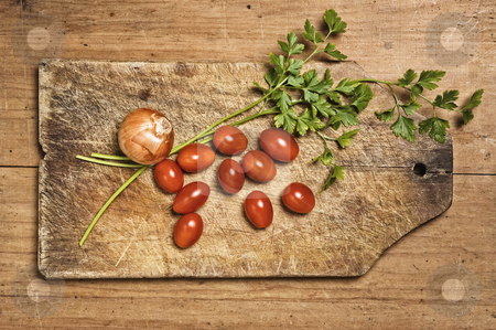 Tomato, parsley and onion on wooden table. stock photo, Tomato, parsley and onion on wooden table. by Pablo Caridad