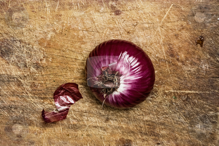 Spanish red onion on wood background stock photo, Spanish red onion on wood background by Pablo Caridad