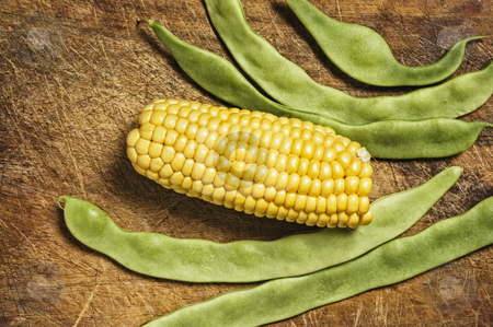 Green beans and corn on wooden table. stock photo, Green beans and corn on wooden table. by Pablo Caridad