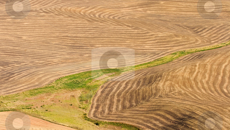 Crop Patterns stock photo, Furrows and lines of various fields tilled in the Palouse Hills of Eastern Washington by Mike Dawson