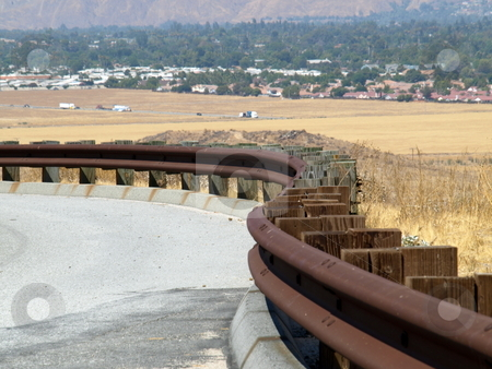 Rusted Railing Curves stock photo, Rusted Railing curves down road by Joseph Ligori