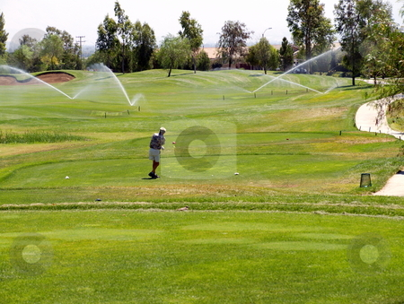 Golf into Sprinklers stock photo, Golf Sprinklers at Tee Box by Joseph Ligori