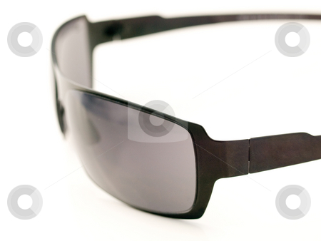 Sunglasses closeup stock photo, Black pair ofsunglasses with shallow  depth of field against white background by Laurent Dambies