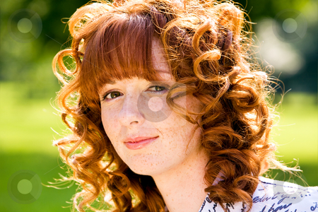 Bright portrait of red-haired young woman outdoors stock photo, Close-up bright portrait of red-haired lovely young woman outdoors by Vitaly Sokolovskiy
