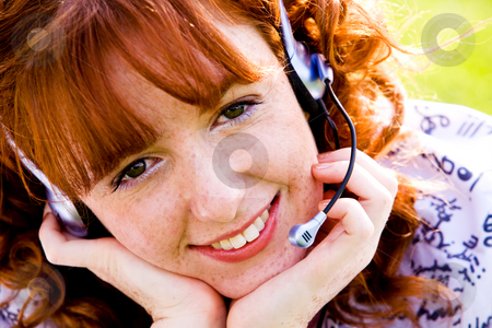 Phone operator stock photo, Close-up portrait of red-haired lovely young woman with headset outdoors by Vitaly Sokolovskiy