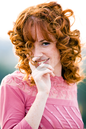 Im very bashful young woman. stock photo, Close-up bright portrait of red-haired lovely young woman outdoors by Vitaly Sokolovskiy