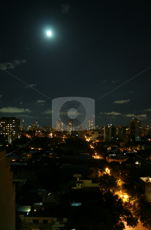 Moon over the city stock photo, Full moon and the city by Johannes Reschl