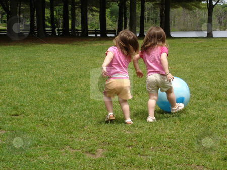 Girls Playing Ball stock photo, Girls playing ball at a park by Bill Parmentier