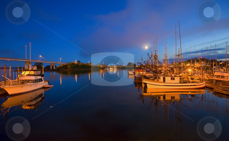 Moon over Sitka Marina stock photo, A half moon rising over the calm waters of Sitka Marina in SE Alaska by Mike Dawson
