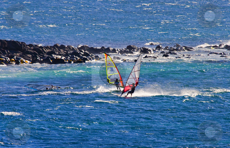 Two wind surfer stock photo, A trio of windsurfers riding the wind and waves off the North Coast of Maui, Hawaii. by Mike Dawson