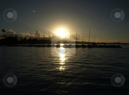Hickam Beach, Oahu, Sailboats, rising sun. stock photo, Sunrise over Hickam AFB Beach marina. by Peter Rolfe