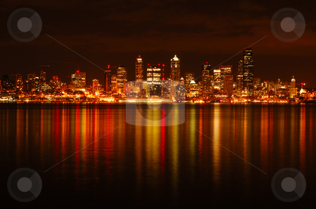 Glittering Seattle Skyline stock photo, A glittering image of golden lit Seattle downtown reflected across Puget Sound by Nilanjan Bhattacharya