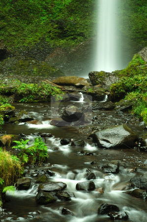 Heavenly falls stock photo, Silky water flowing into a stream from a waterfall by Nilanjan Bhattacharya