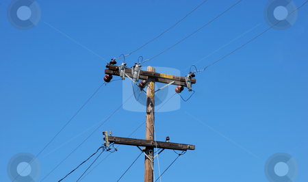 Wooden Electric Pole stock photo, Woden Electric Pole With Cables Going Diagonally Shown Against Blue Sky by Denis Radovanovic
