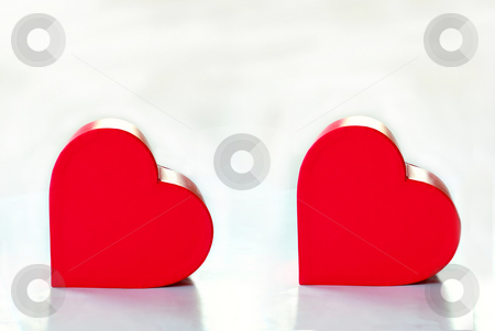 Two red hearts isolated stock photo, Two red heart box isolated over white background by Julija Sapic