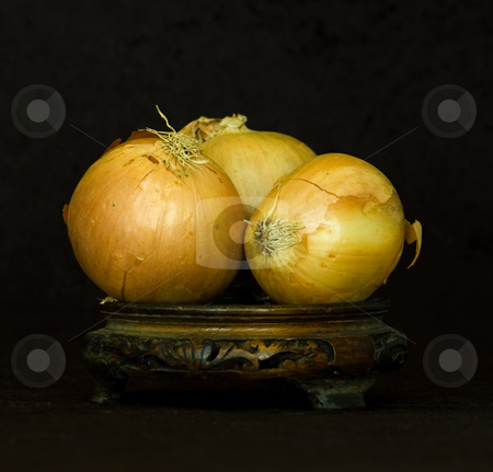 TEAR JERKERS stock photo, Spanish Onions on wooden stand against velvet background by Elf Evans