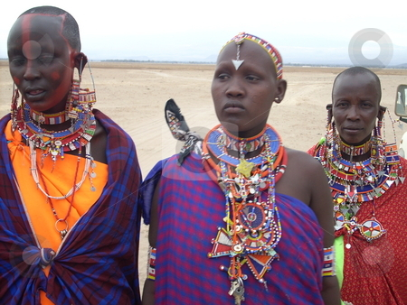 Young Masai Women in traditional dress stock photo, Beautifull young Masai women in their traditional attire decked with bright, colorful necklaces. by Rose Nthiwa