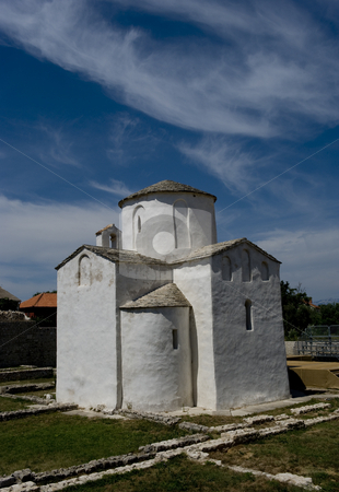 The smallest cathedral in the world stock photo, This is told to be the world's smallest cathedral, build in the city Nin in Croatia, around year 800. It was the seat of Bishop Greogory. Nin is a beautiful old and quite small city at the west coast of Croatia. by Flemming Jacobsen