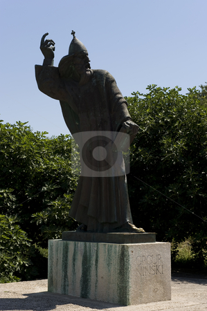 Bishop Gregory of Nin, Croatia stock photo, Bishop GRGUR NINSKI. Statue located in the city Nin in Croatia.   Gregory of Nin (Croatian: Grgur Ninski) was a 10th-century bishop that strongly opposed the Pope and official circles of the Church and introduced the Croatian language in the religious services after the Great Assembly in 926. Until that time, services were held only in Latin, not being understandable to the majority of the population. Not only that this was important for Croatian language and culture but it also made the religion stronger within the Kingdom of Croatia. by Flemming Jacobsen