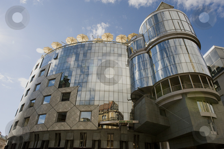 Haas house, Vienna stock photo, Haas House in the city of Vienna, Austria. It's located just opposite of St. Stephen's cathedral  Haas House is one of the most exciting buildings in Vienna and the city's pride. The square of St. Stephen's cathedral is opened up by the glass facade. Images of St. Stephen's Cathedral reflected by the straight glass facade of Haas House are a popular motif. The building is created by the Viennese architect Hans Hollein. by Flemming Jacobsen