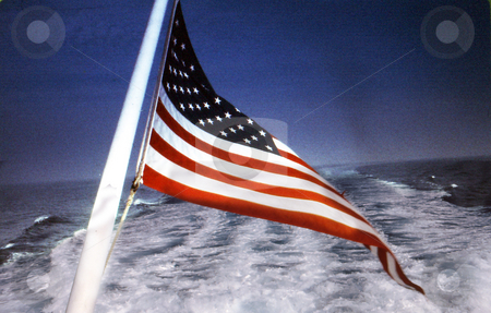 Flag in wake stock photo, Flag in wake of boat by Joseph Ligori