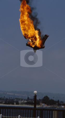 Man on Fire stock photo, Stunt man set on fire jumping from above. Flaming by Joseph Ligori