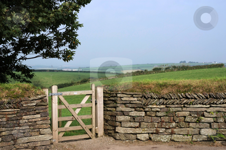 Entry stock photo, Entry into a field through gate in a traditional dry-stone wall by Paul Phillips