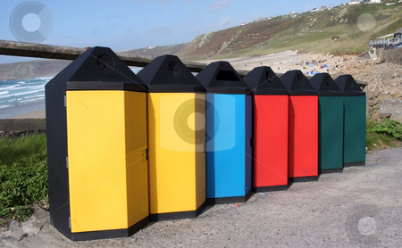 Trash stock photo, A group of different coloured trash cans by Paul Phillips