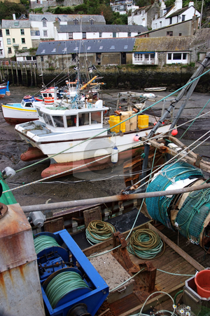 Fishing boats stock photo, Fishing boats in dock at low tide by Paul Phillips