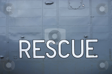 Rescue stock photo, Rescue sign painted in white on a helicopter by Paul Phillips