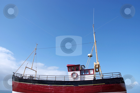 Sea fishing stock photo, A bright red fishing boat at sea by Paul Phillips
